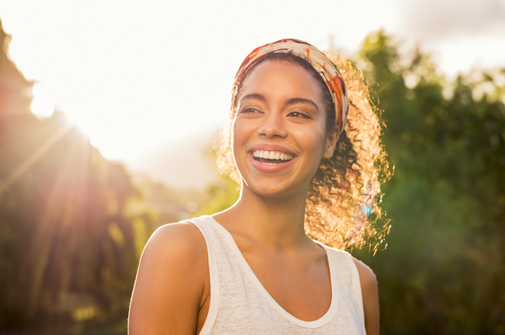young woman-looking to the side-and-smiling